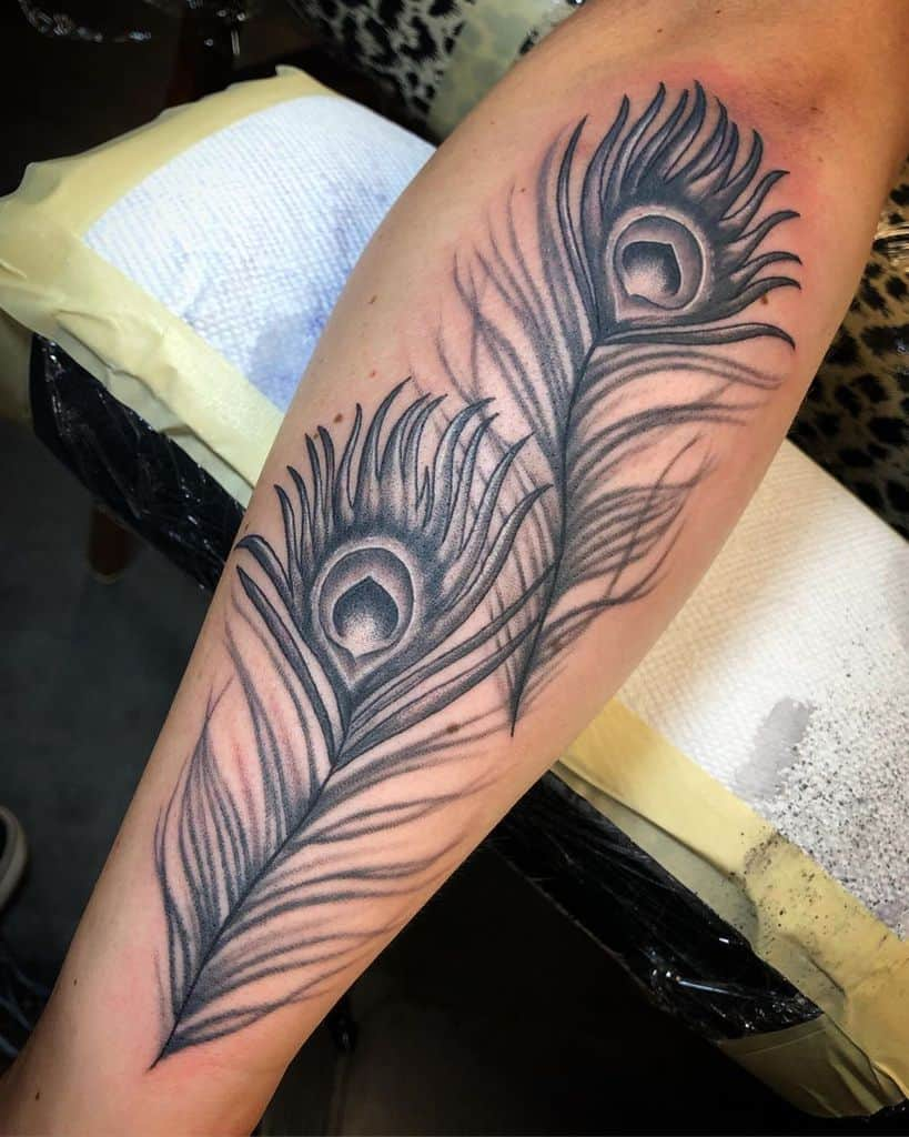Black And Grey Leg Peacock Feather Tattoo