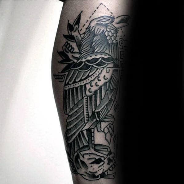 Black And Grey Skull With Crow Traditional Tattoo On Mans Leg