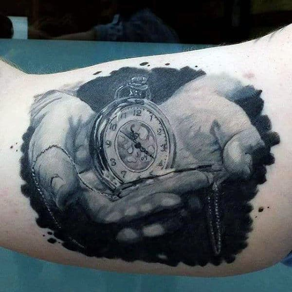 Black And Grey Timepiece In Hands Tattoo Male Arms