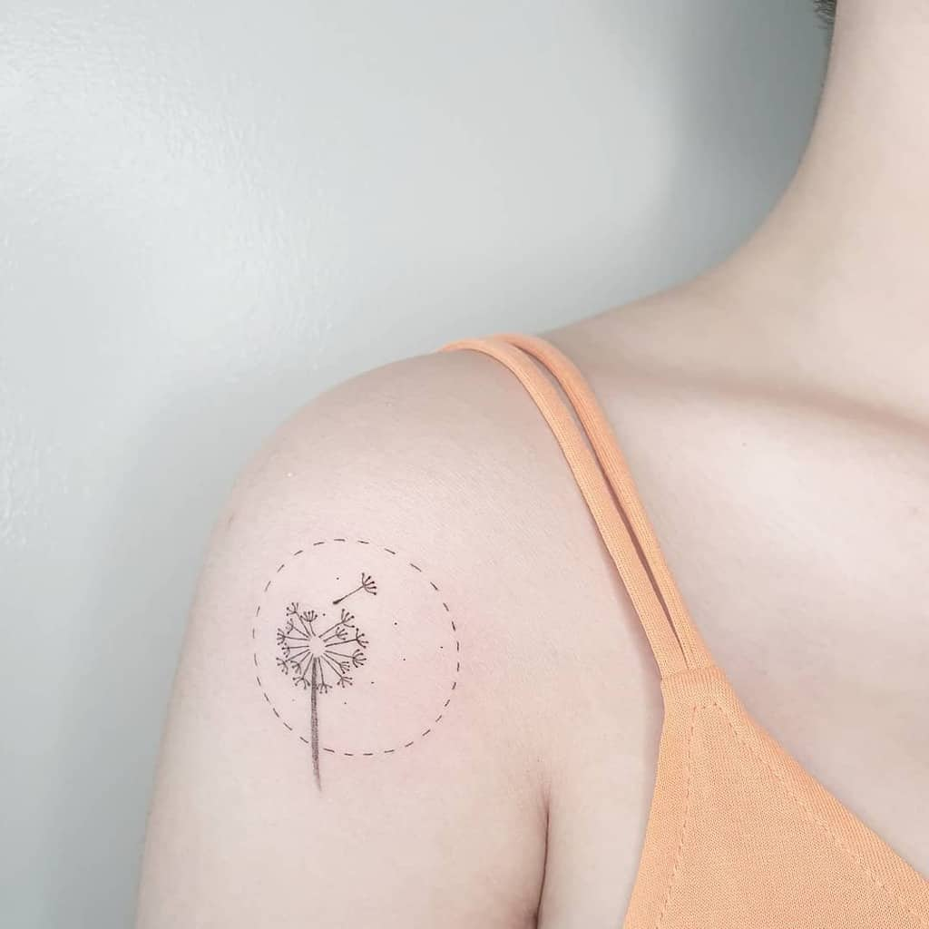 black and grey tiny dandelion tattoo