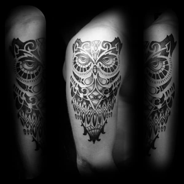 Black And Grey Tribal Owl Arm Tattoo On Gentleman
