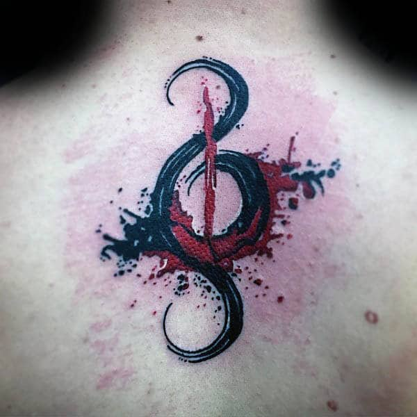 Black And Red Treble Clef Watercolor Upper Back Tattoo On Man