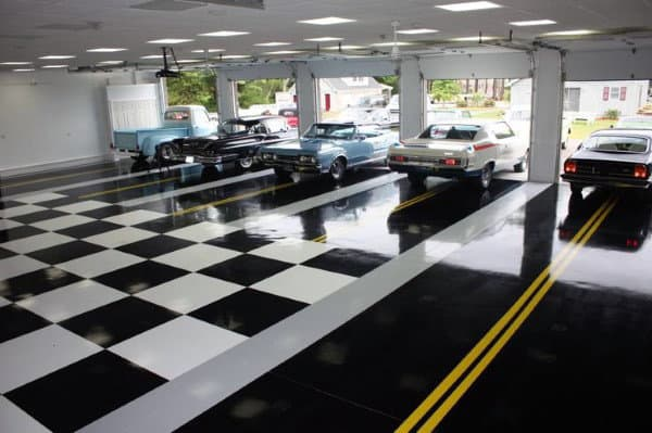 Black And White Checkered Garage Floor With Yellow Road Lines