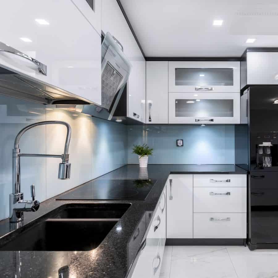 Black And White Kitchen With Wood Color Elements 2