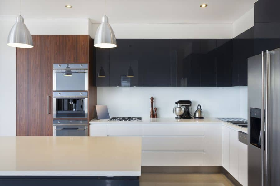 Black And White Kitchen With Wood Color Elements 7