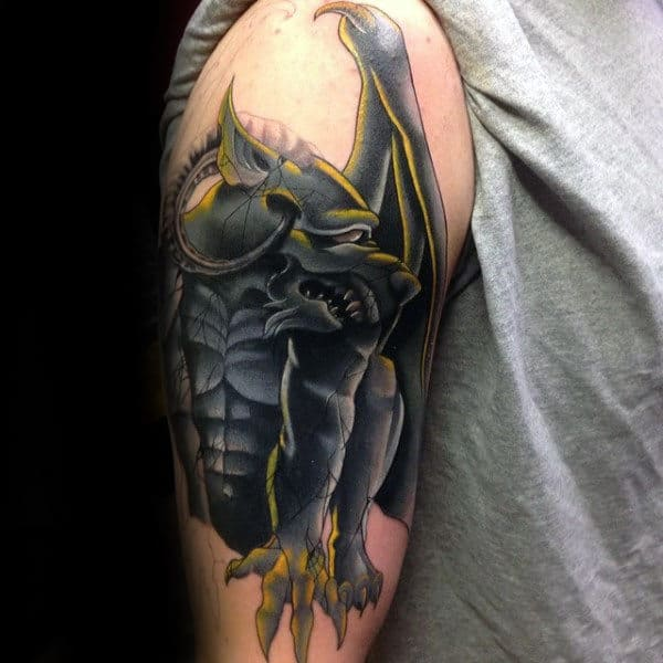 Black And Yellow Gargoyle Guys Arm Tattoo