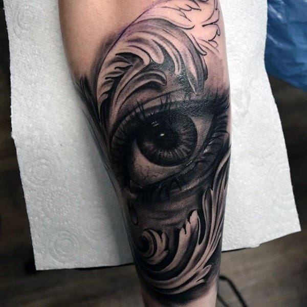 Black Eye With Teardrop And Gray Feather Tattoo Mens Forearms