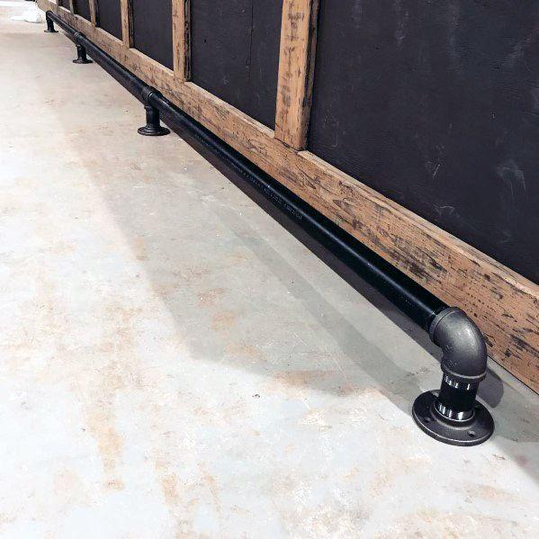Black Industrial Interior Bar Foot Rail Design