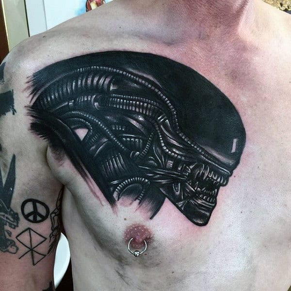 Black Ink Alien Tattoo On Guys Chest