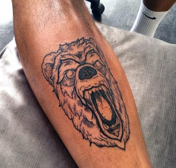 Black Ink Bear Face Shin Tattoo On Man