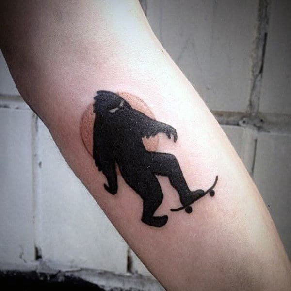 Black Ink Bigfoot Skateboard Tattoos For Guys