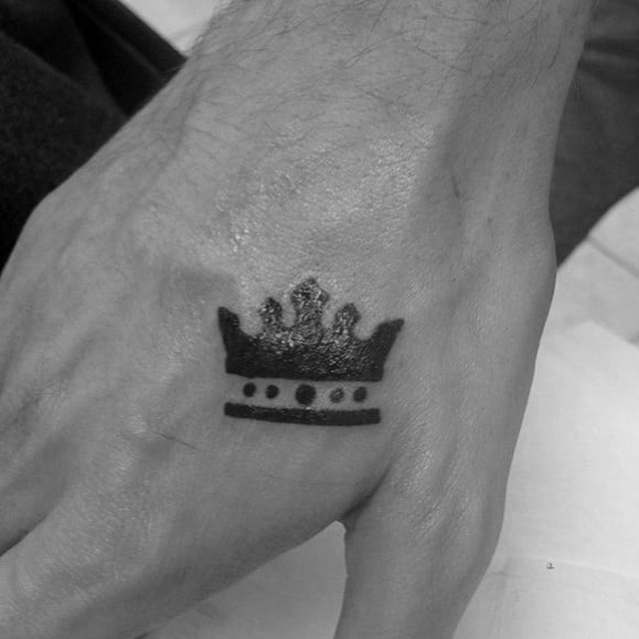 Black Ink Crown Guys Small Tattoo On Hand