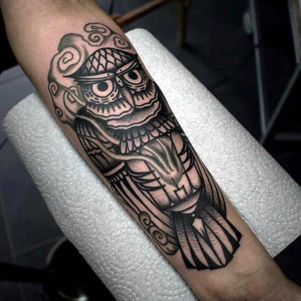 Black Ink Forearm Male Tattoo Of Traditional Owl
