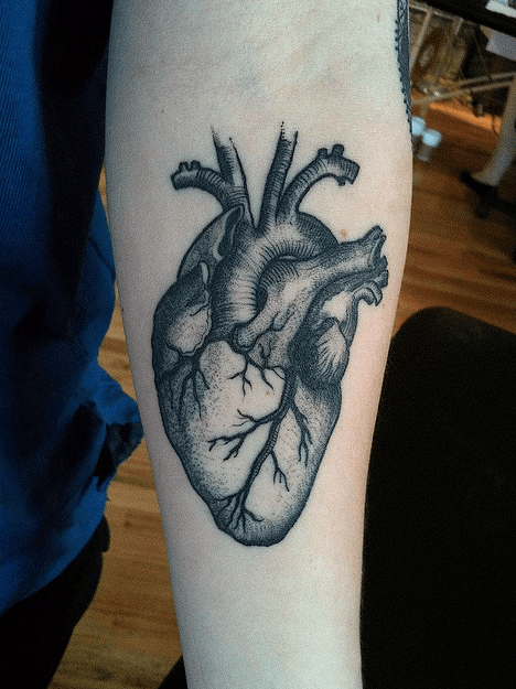 Black Ink Heart Tattoo On Man Forearm