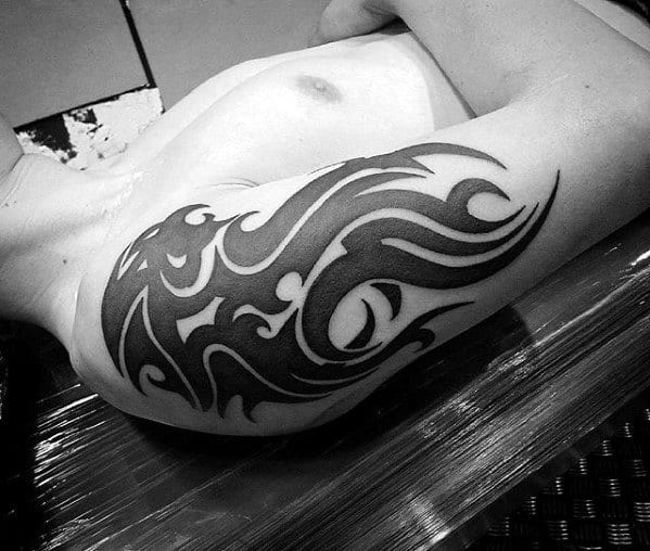 Black Ink Lion Mens Sick Tribal Tattoo On Arm