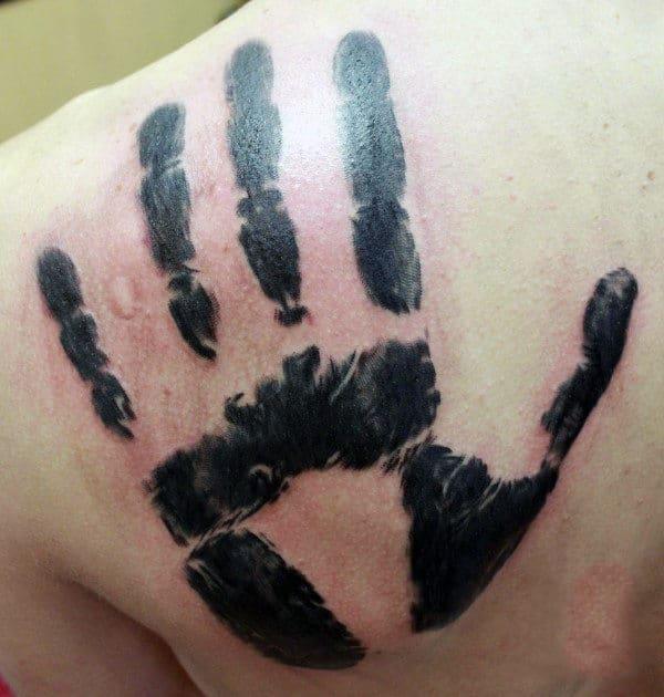 Black Ink Male Handprint Back Tattoos