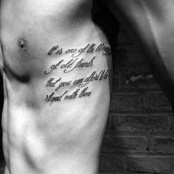 Black Ink Male Rib Quote Cursive Tattoos