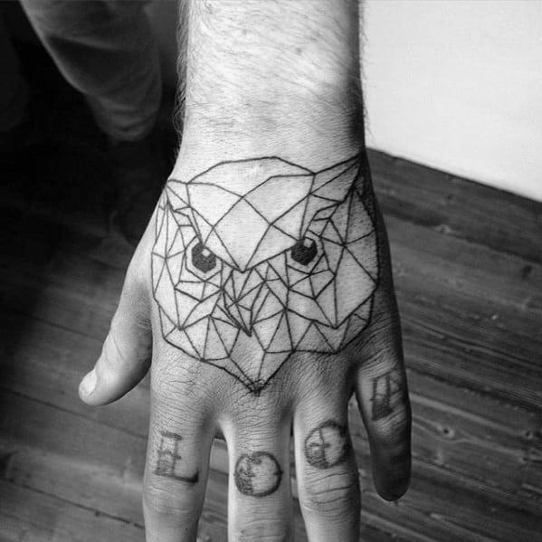Black Ink Outline Geometric Owl Hand Tattoo On Man