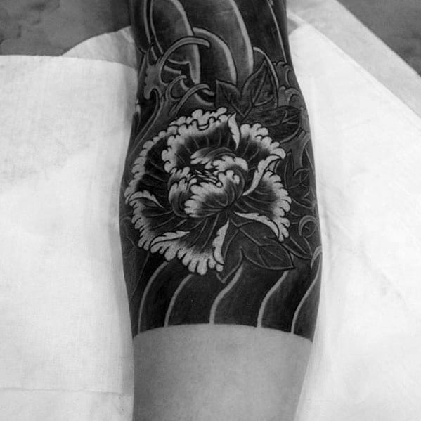 Black Ink Shaded Japanese Flower Tattoo On Male