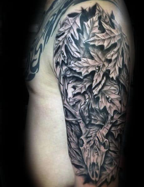 Black Ink Shaded Mens Deer Skull Camouflage Leaves Half Sleeve Tattoos