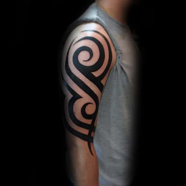 Black Ink Tattoo Of Traditional Classic Tribal Design On Guy