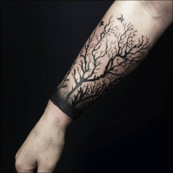 Black Ink Tree Branches Male Forearm Tattoo