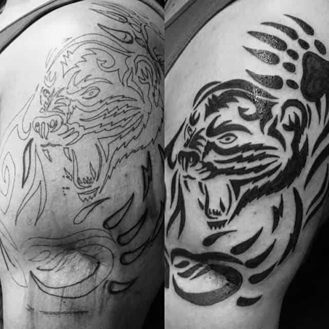 Black Ink Tribal Bear Claw Upper Arm Tattoos On Gentleman