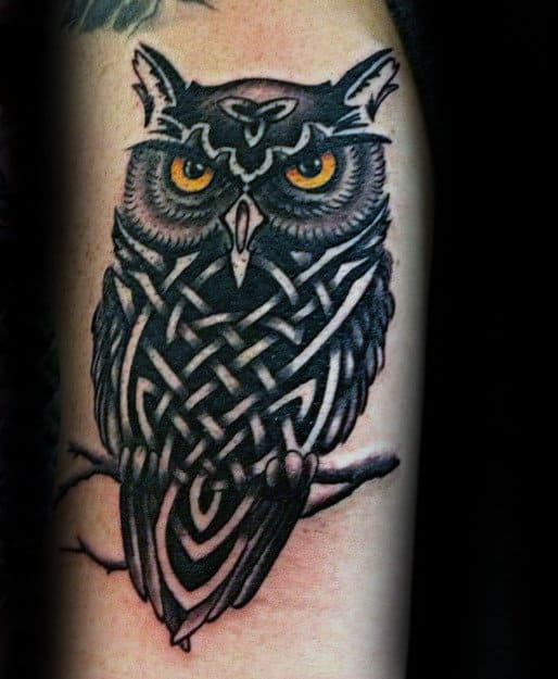 Black Ink Tribal Owl With Glowing Eyes Tattoo For Men On Arm