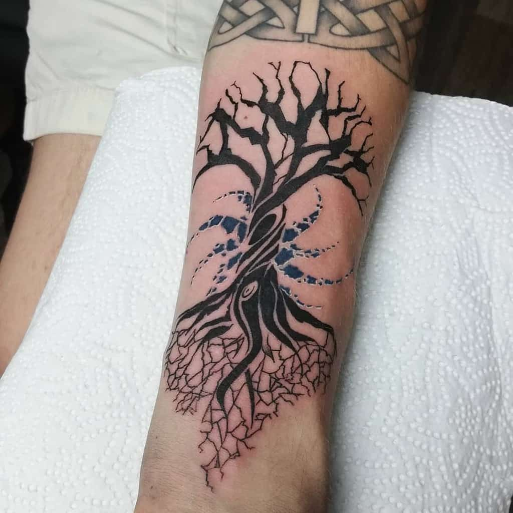 black ink yggdrasil arm tattoo