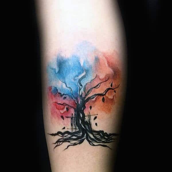 Black Leaves Falling Out Of Watercolor Tree Tattoo Male Forearms
