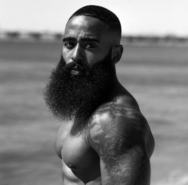 Black Male With Full Length Beard Style And Short Haircut