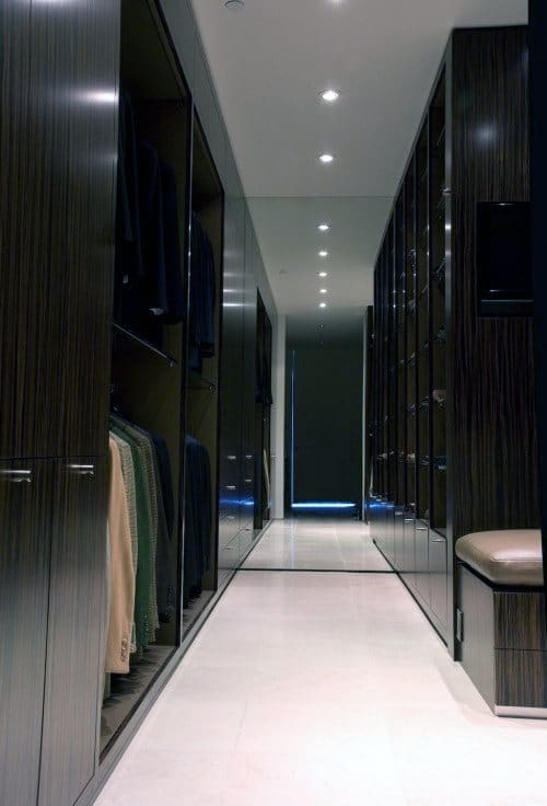Black Modern Mens Walk In Closet With White Marble Floors