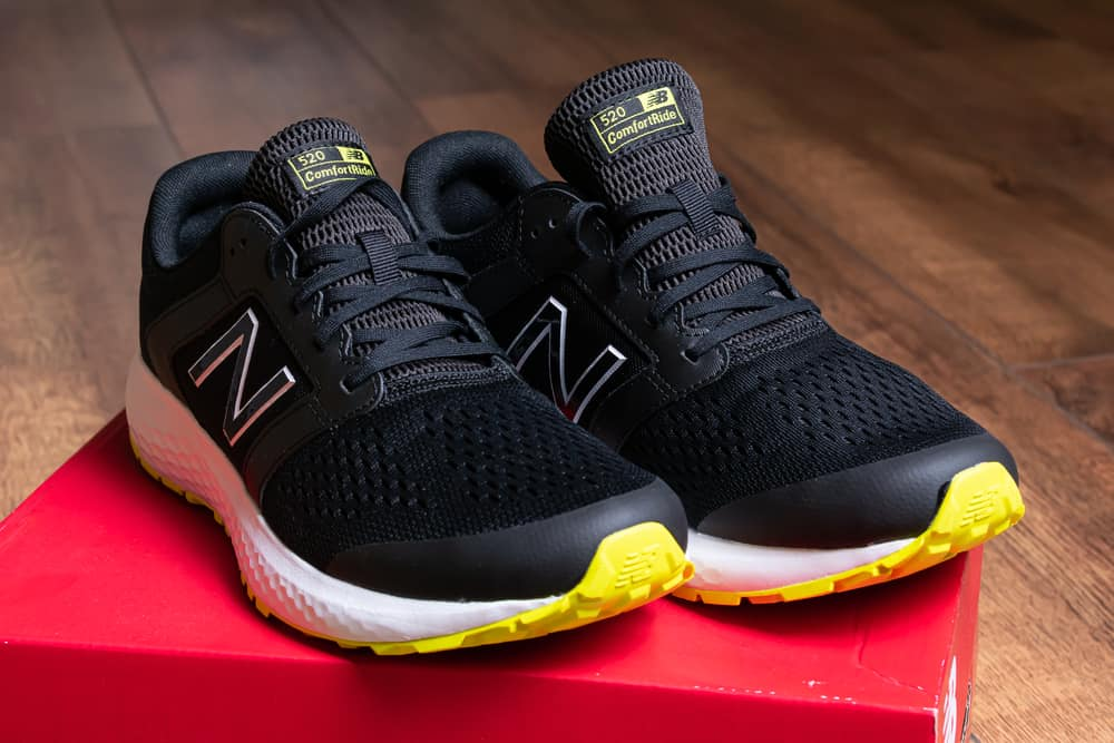 black new balance shoes on red box