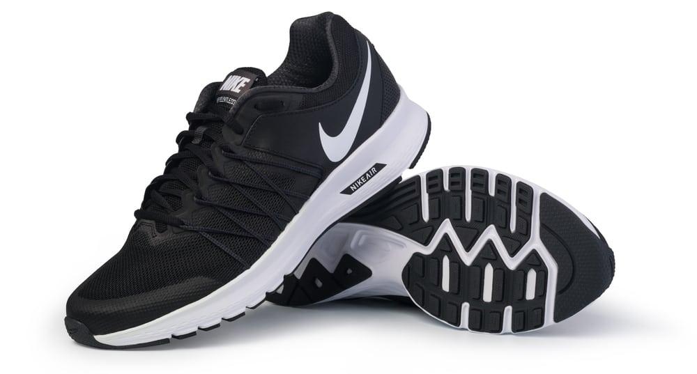black nike shoes on white surface