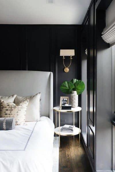 Black Painted Bedroom With Hardwood Floors