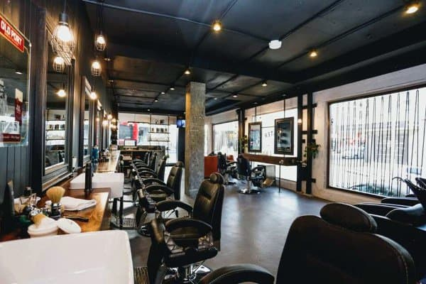 Black Painted Ceiling With Concrete Floors Barber Shop Designs