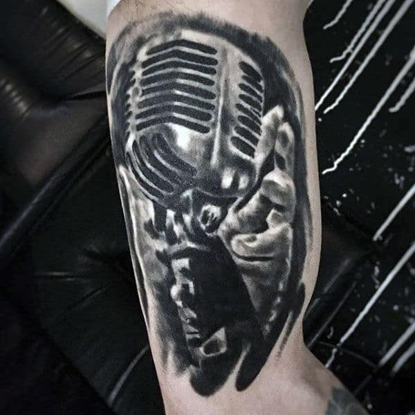 Black Pencil Shade Of Hand Holding Microphone Tattoo Guys Arms