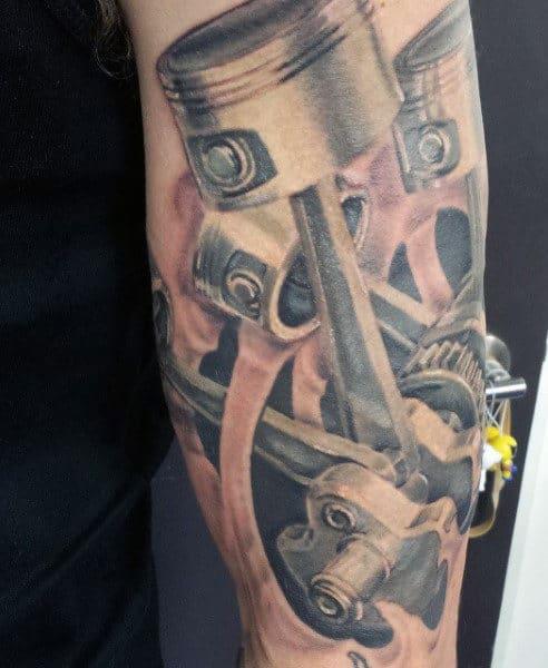 Black Pistons Tattoo On Men