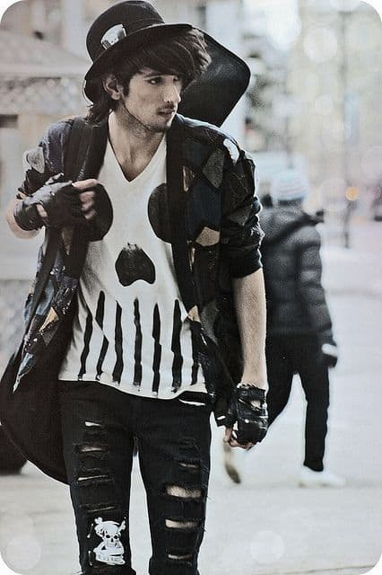 Punk man with ripped black jeans