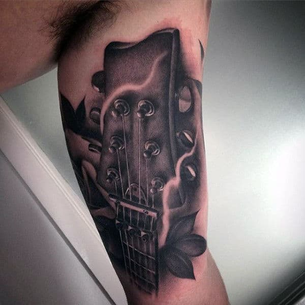 Black Shaded Guitar Head Tattoo For Men On Inner Arms