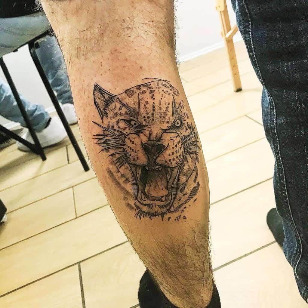 black-sketch-graphic-jaguar-tattoo-illeotattooer