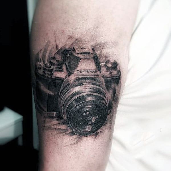 Black Sketch Of Olympus Camera Tattoo Male Arms