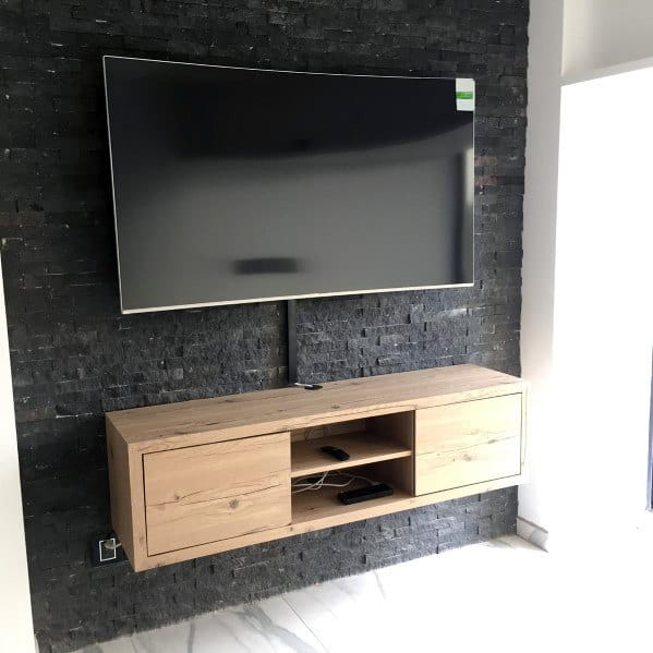 Black Stone Tile Wall With Wood Free Floating Stand Television Wall Ideas