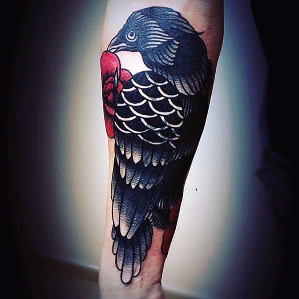 Black Traditional Crow With Red Flowers Mens Outer Forearm Tattoo