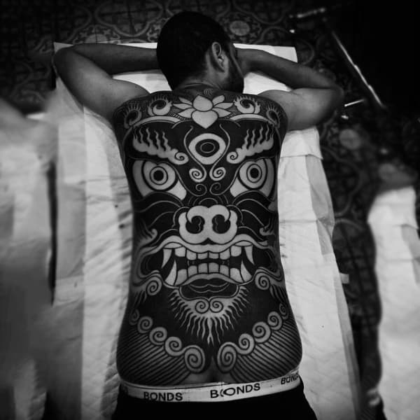 Black Tribal Large Eyed Face Tattoo Mens Full Back