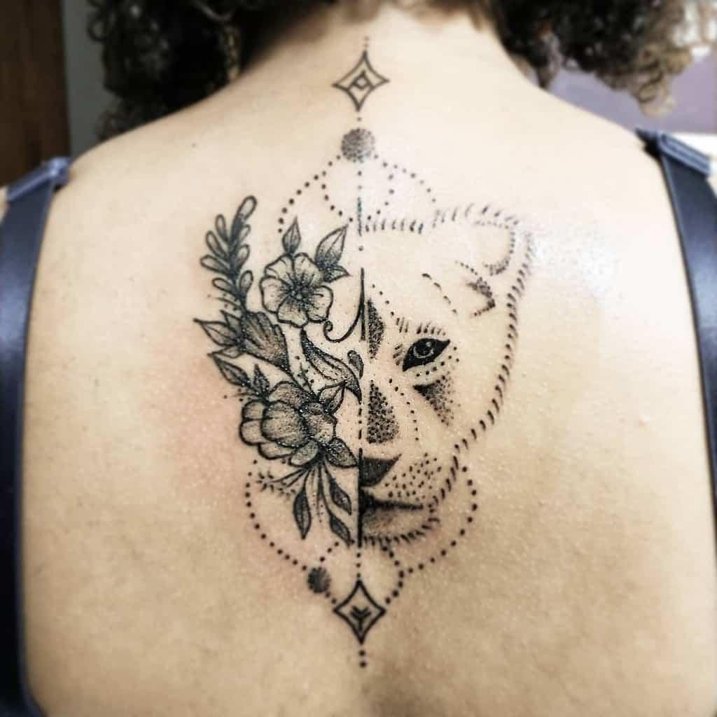 Black Work Flower Lioness Tattoo