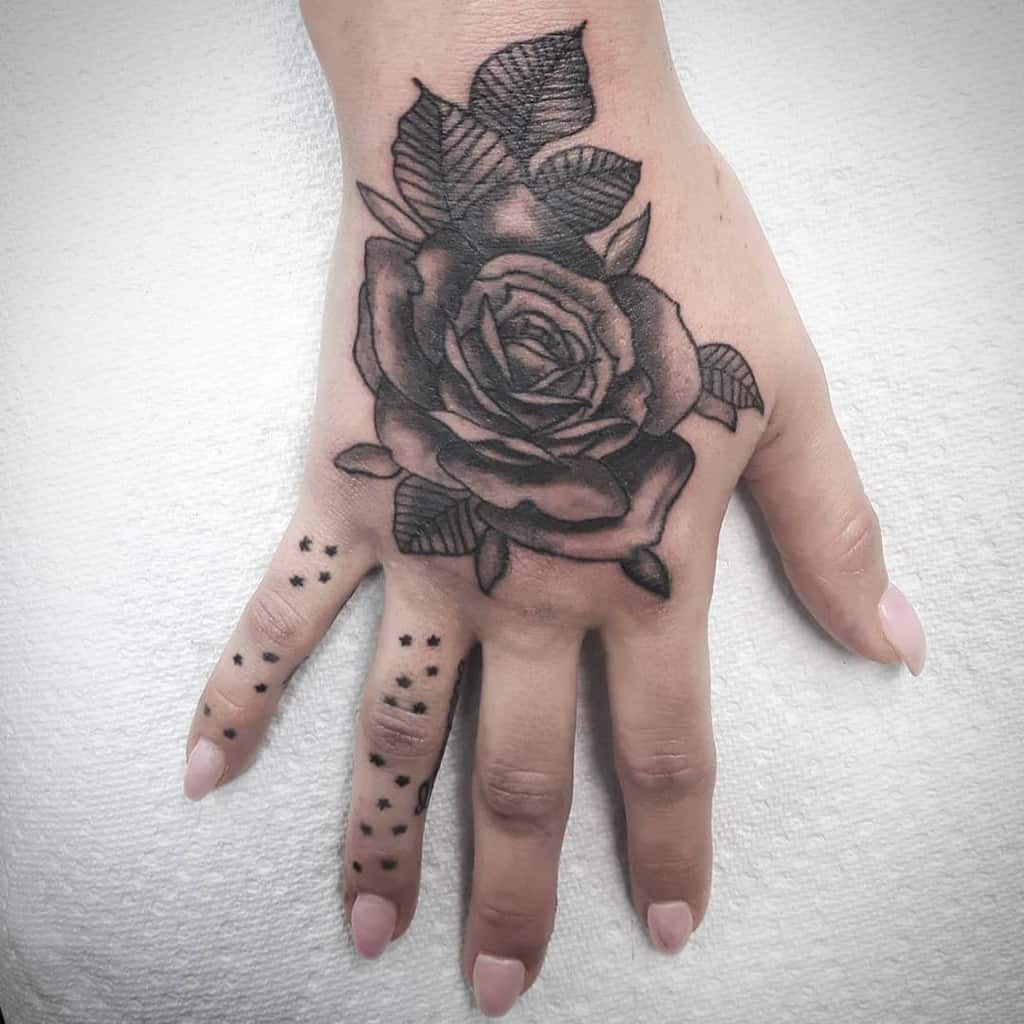 blackwork rose hand tattoos phasqotattoo