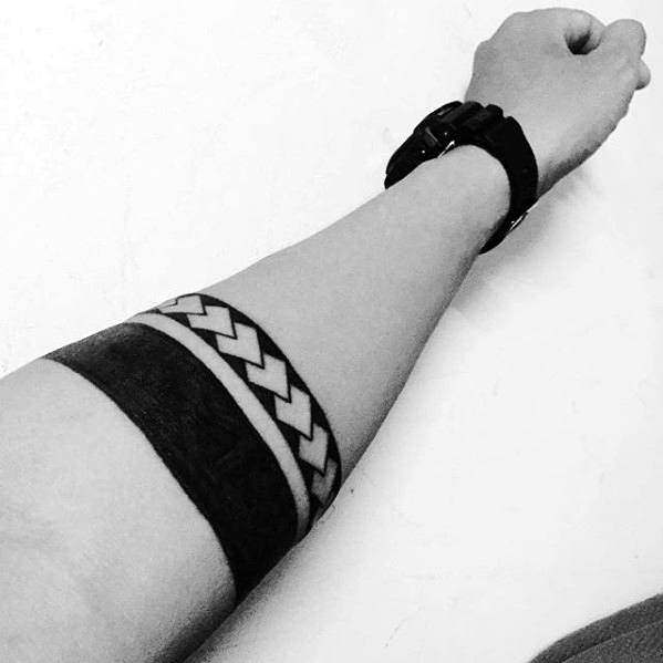Blackwork With Negative Space Pattern Male Armband Tribal Tattoos
