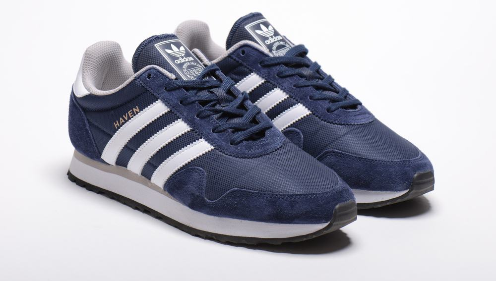 blue adidas shoes on white surface