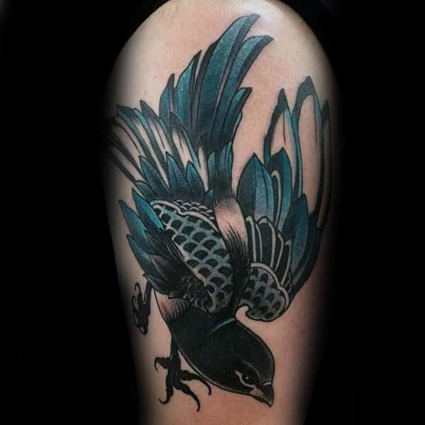 Blue And Black Ink Guys Traditional Bird Thigh Tattoo